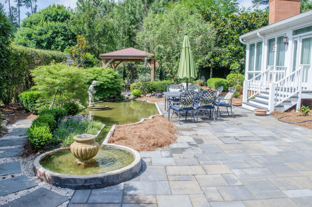 Incredible Augusta, GA Backyard Flower Garden, Fountain, and Patio 1
